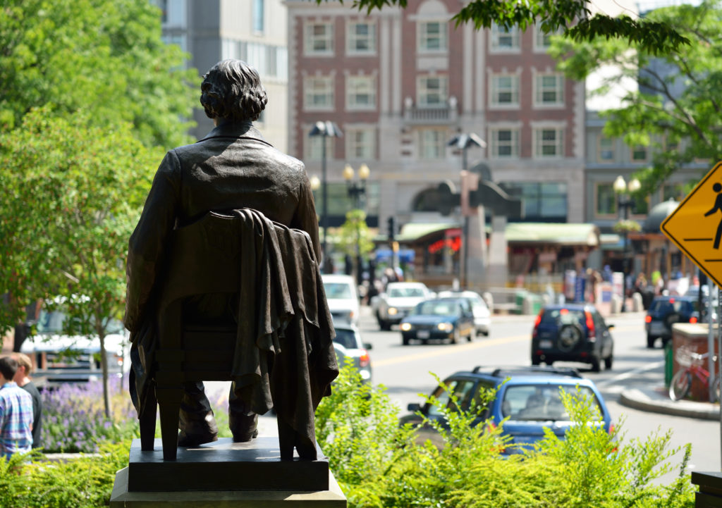 a view of harvard square and a statue