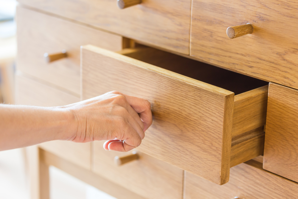 pulling out a drawer in an apartment
