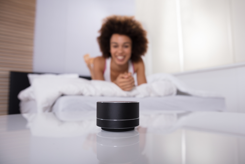 a woman with a smart speaker