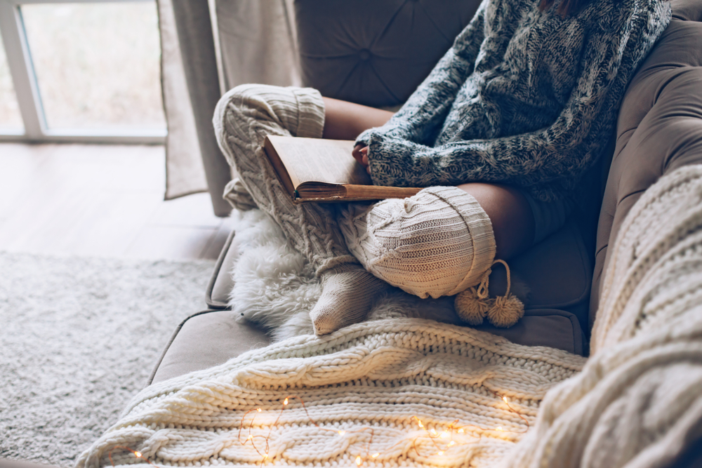 a person cozy on the couch