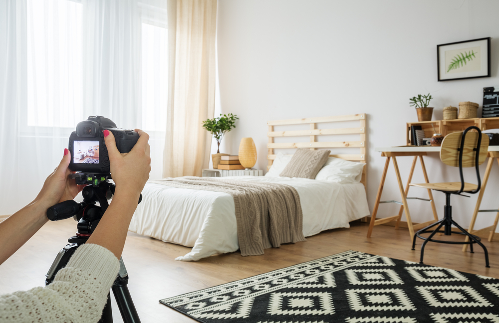 taking a photo of a bedroom