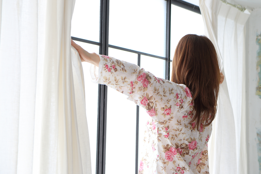 opening up curtains