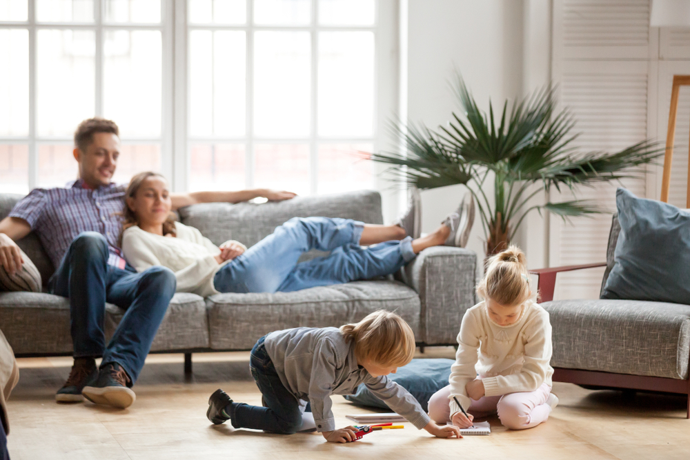 a family hanging out in the living room