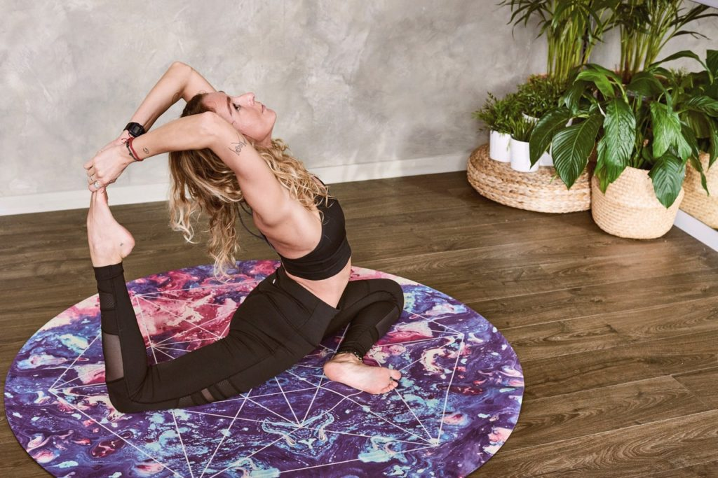 a woman doing a challenging yoga move