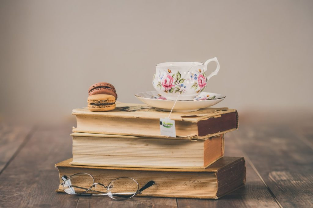 stacked books with a teacup on top
