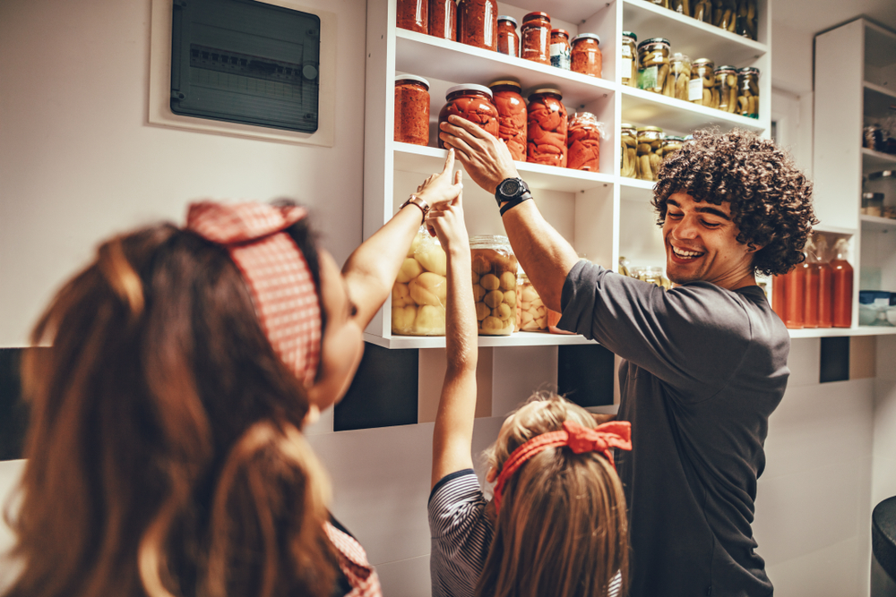 grabbing food from the pantry with family
