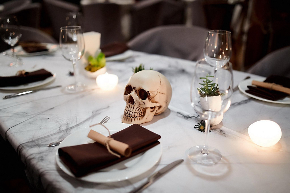 Halloween dinner setting with a skull