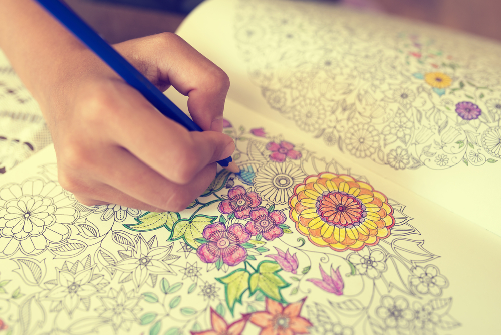 filling in a coloring book