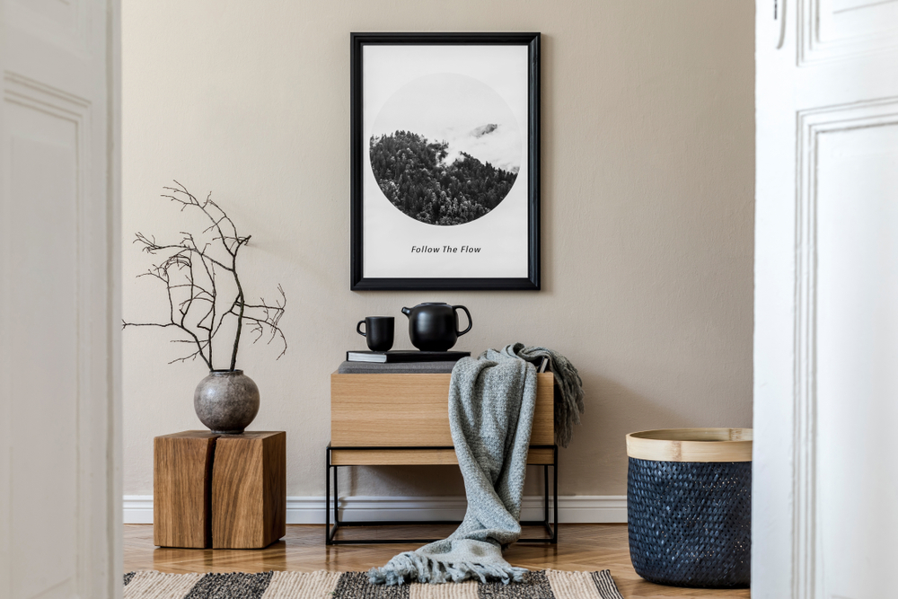 framed art in an entryway | how to make an apartment look more adult