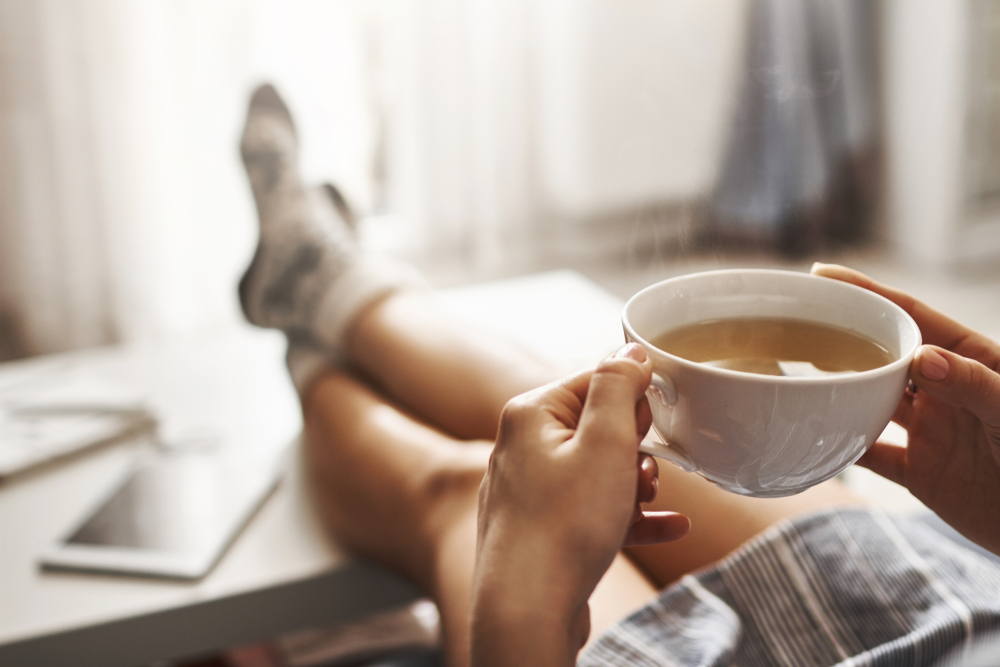 holding a cup of tea