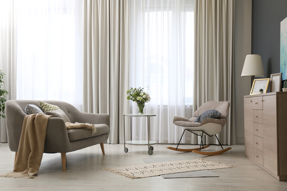 curtains in a room | ways to make ceilings look taller