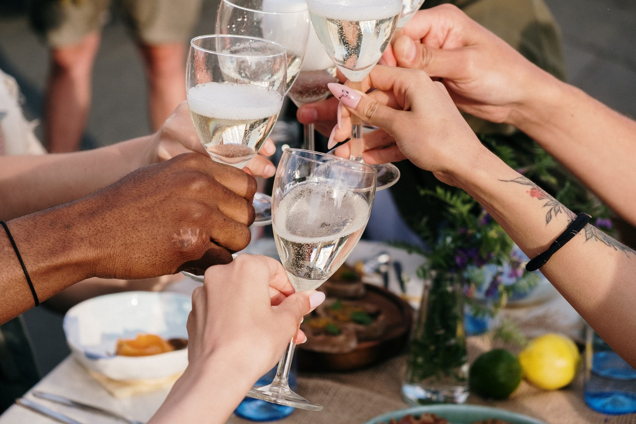 cheers at a dinner party