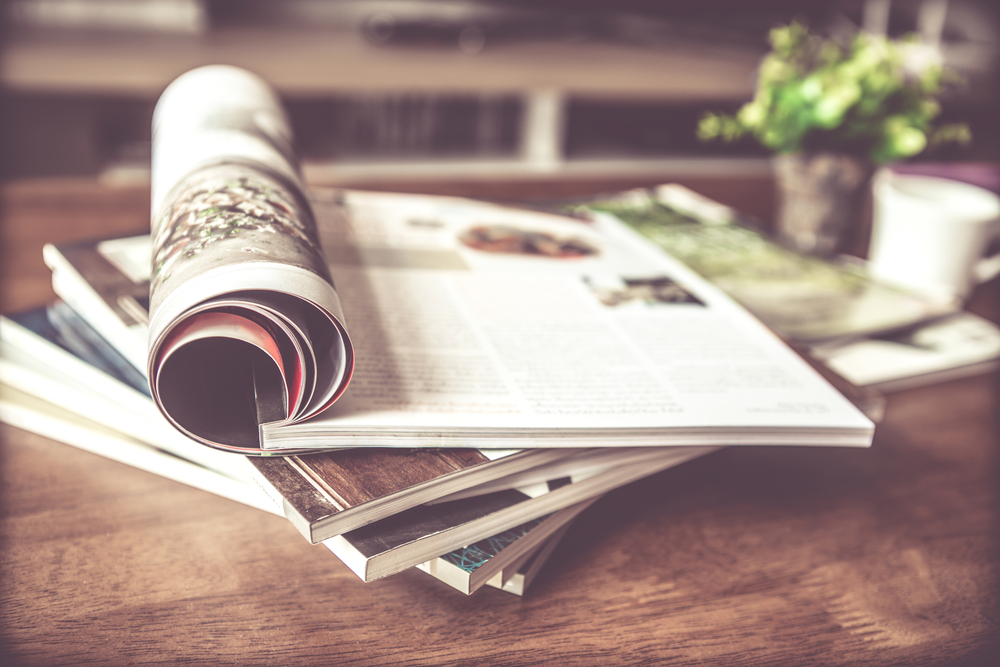 a stack of magazines | curate your own gallery wall